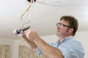 electrician installing a ceiling fan